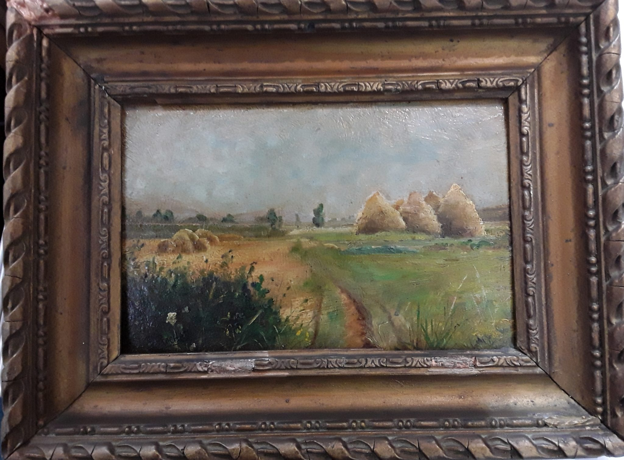 Oil painting of hayricks by S Rochat