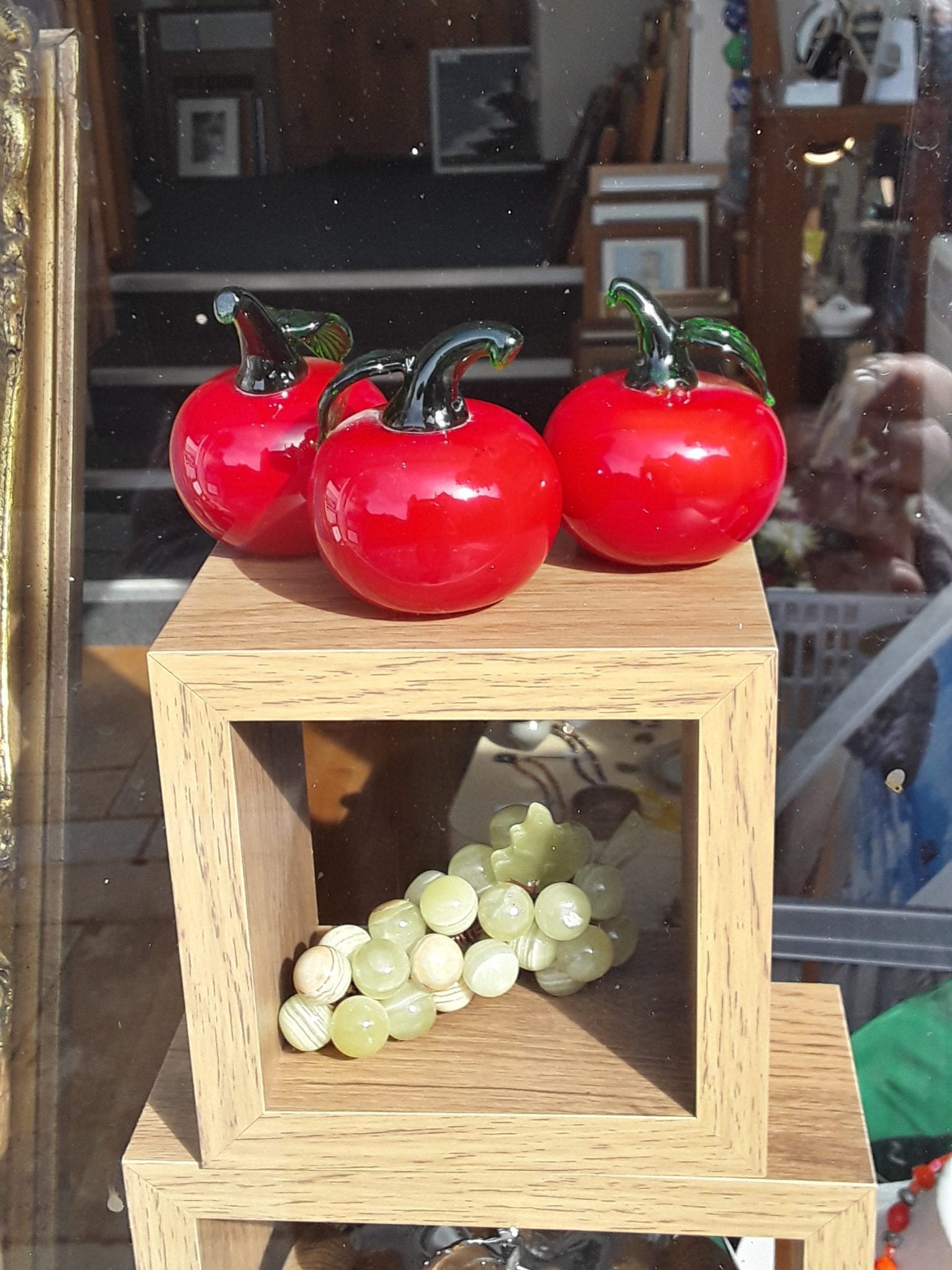 Glass apples and onyx grapes